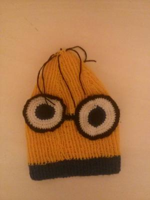 Kids hat modelled after minions figure.