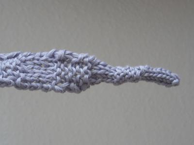 Zipfel vom grauen Schal