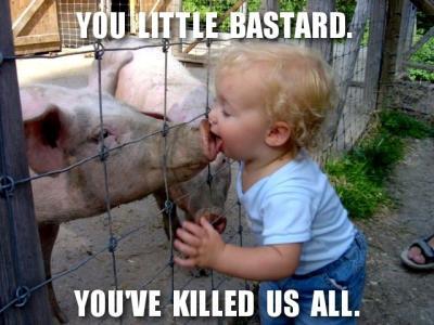child kissing pig