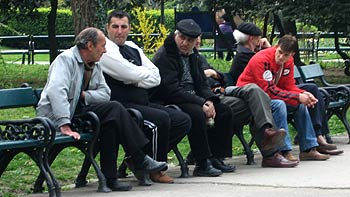 Men on a park bench. (novala)