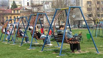 People on swings. (novala)
