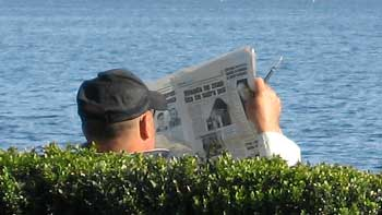 Reading a newspaper. (novala)